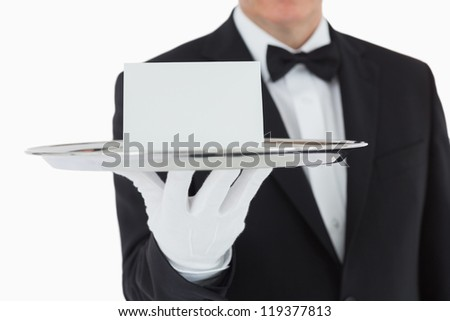 Man holding silver tray with white blank card - stock photo