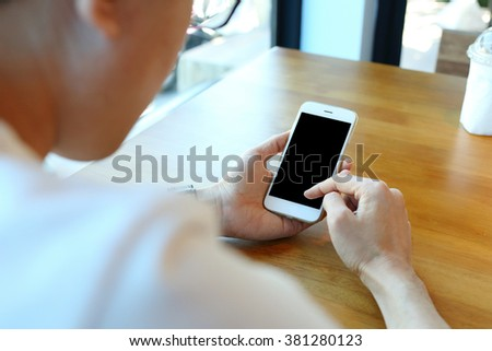 Man holding smartphone with touch on screen - stock photo
