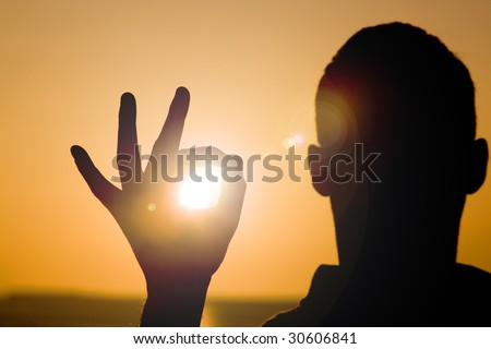 Man Holding Sun - stock photo