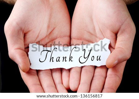 Man holding thank you word in palm - stock photo