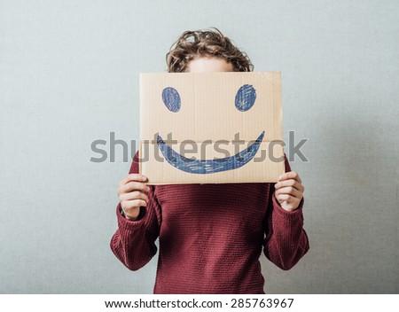 man holding the sad smiley - stock photo