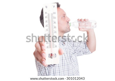 Man holding thermometer and drinking cold water. Summer heat and dehydration concept isolated on white - stock photo