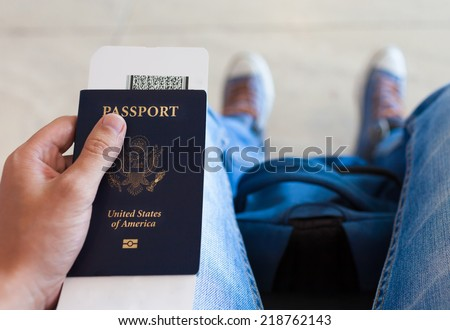 Man holding ticket and passport  - stock photo