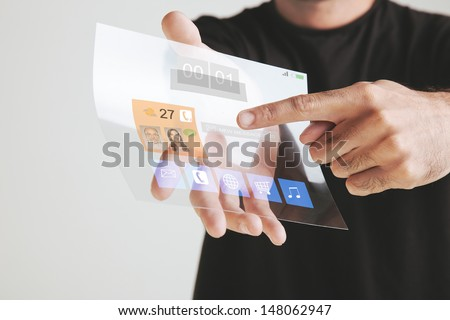 Man holding transparent future tablet made of graphene.   - stock photo