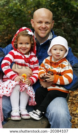man holding two children on lap - stock photo