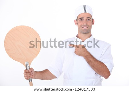 Man holding up a pizza peel - stock photo