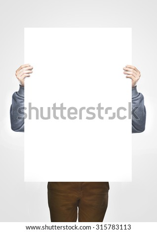 man holding white blank poster - stock photo
