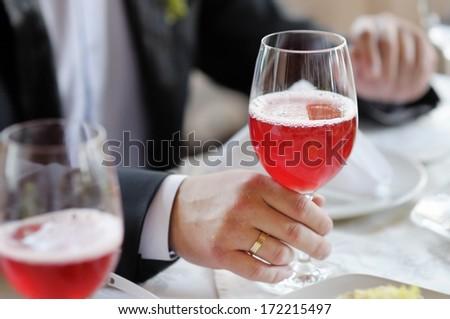 Man holding wine glass - stock photo