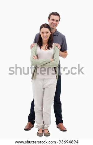 Man holding woman by the shoulders against white background - stock photo