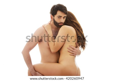 Man holding woman's leg while embracing. - stock photo