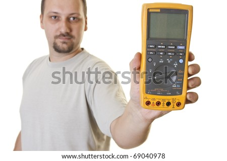 man holds a professional electrical multimeter - stock photo