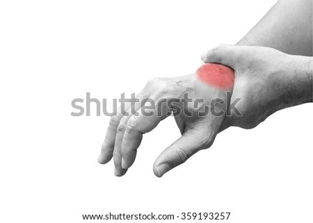 Man holds his hand acute pain in a wrist - stock photo