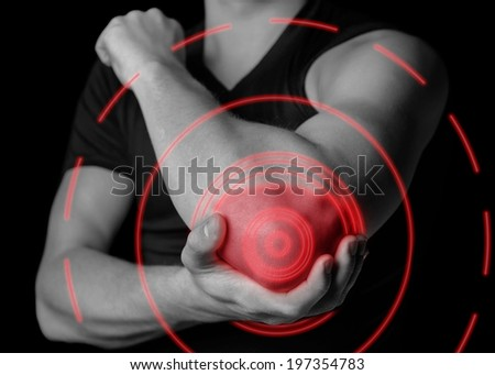 Man holds his the elbow joint, acute pain in the elbow, black and white image, pain area of red color - stock photo