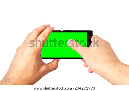Man holds in two hands and taps by thumb tablet PC in landscape mode with green screen isolated on white. Chroma key screen for placement of your own content.  - stock photo