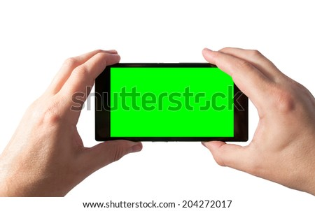 Man holds in two hands tablet PC in landscape mode with green screen isolated on white. Chroma key screen for placement of your own content.  - stock photo