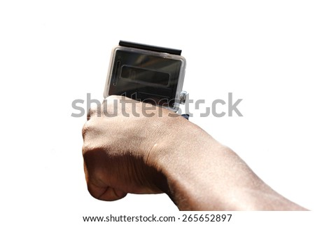 Man holds small extreme digital camera in hand, isolated on white background - stock photo