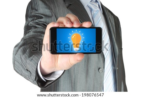 Man holds smart phone with idea concept on white background   - stock photo