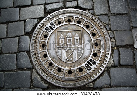 Man hole cover in Prague, Czech republic - stock photo