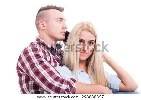 Man hugging woman and talking on the phone with another female or girl. Cheating boyfriend concept - stock photo