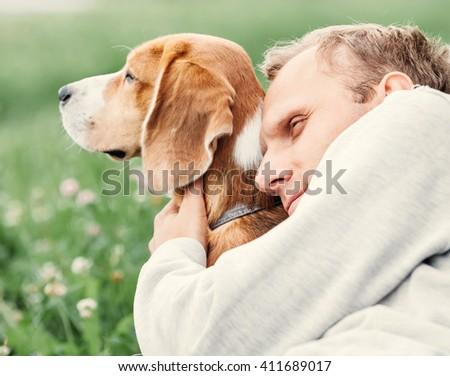 Man hugs his favorite dog - stock photo