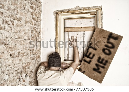 Man imprisoned in a house - stock photo