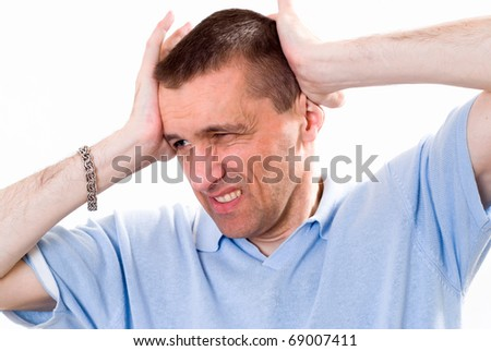 man in a blue shirt standing - stock photo