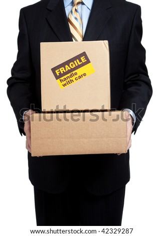 Man in a business suit holding moving boxes with a fragile sticker on it on a white background - stock photo