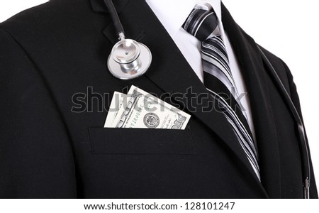 man in a business suit with a stethoscope and money in pocket isolated on white background - stock photo