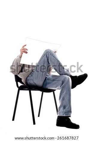 man in a chair with a magazine on a white background - stock photo