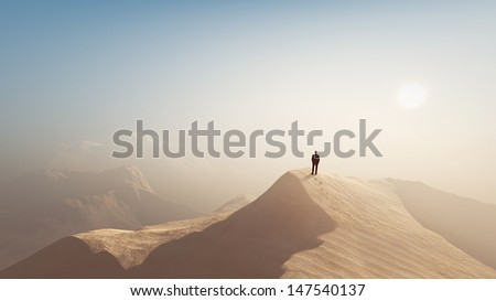man in a desert - stock photo