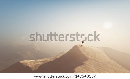 man in a desert - stock photo
