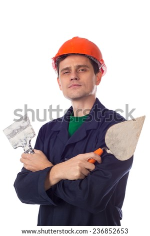 man in a helmet and  blue robe holding building trowel, show thumb - stock photo