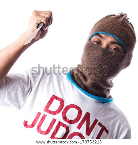 Man in a mask holding knife - stock photo
