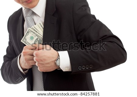 Man in a putting money in his pocket. Isolated over  white - stock photo