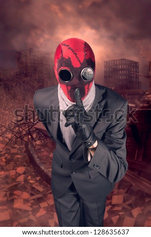 Man in a red mask handmade against the background of the destroyed city - stock photo