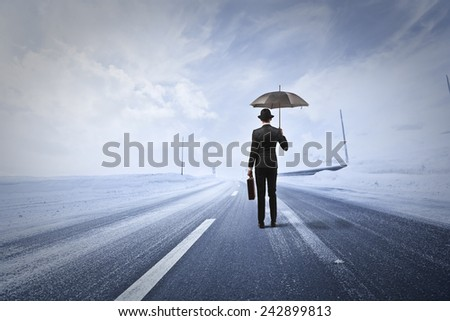 Man in a snowy road  - stock photo