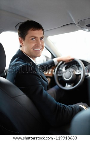 Man in a suit at the wheel - stock photo