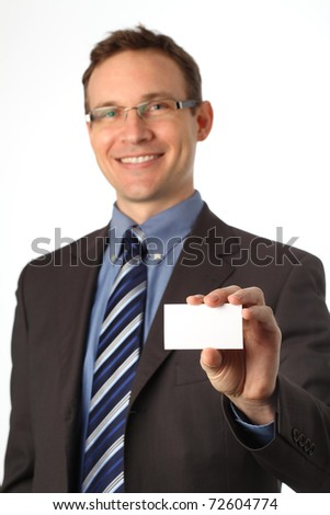 man in a suit holding a blank business card - stock photo