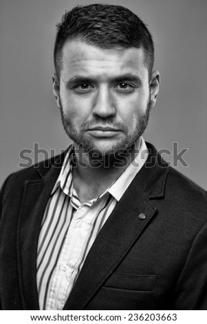 Man in a suit without a tie - stock photo