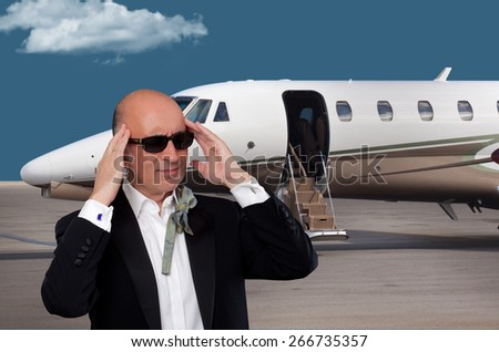 Man in a tuxedo expressing discomfort  - stock photo