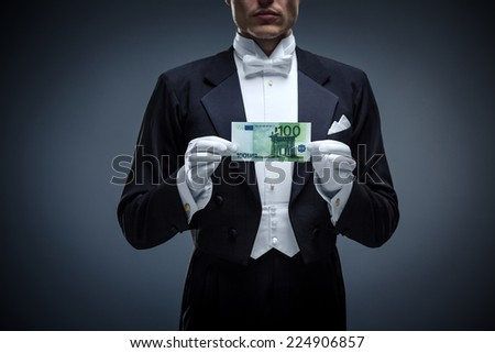 Man in a tuxedo with euro - stock photo