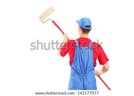 Man in a uniform painting a wall, isolated on white background - stock photo