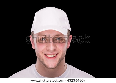man in a white cap on a black background - stock photo
