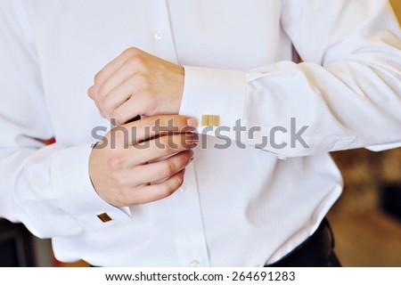 man in a white shirt dress cufflinks. - stock photo