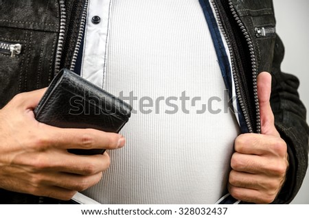 man in a white shirt holding a wallet - stock photo
