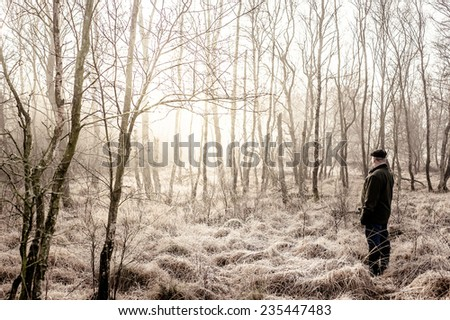 Man in a winter forest - stock photo
