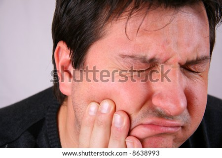 Man in agony (toothache) - stock photo