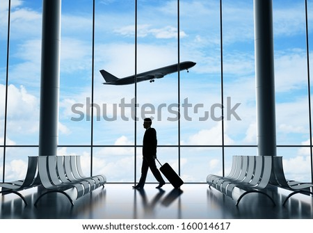 man in airport and airplane in sky - stock photo