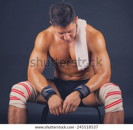 Man in bandage on knees - stock photo