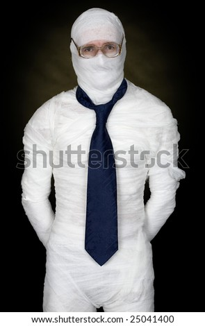 Man in bandage with eyeglasses and  the cravat on black - stock photo